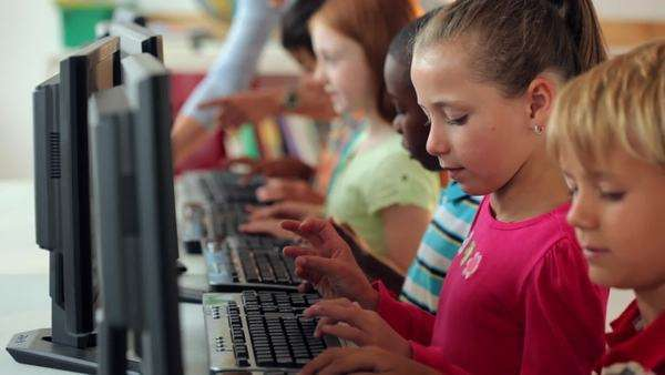 Students using computers in classroom Royalty-free stock video