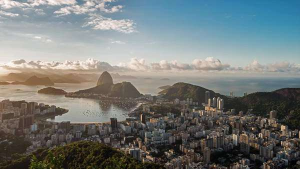 Timelapse over looking Rio, Brazil towards Sugar Loaf Mountain durning the day as clouds sail by in the sky Royalty-free stock video