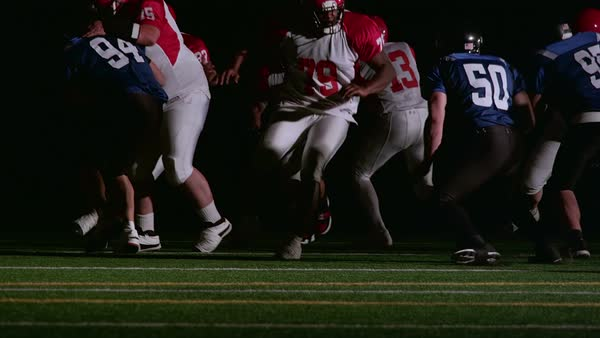 Tilt up of a football play happening in slow motion Royalty-free stock video