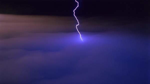 Lightning effects striking downward into a cloudbank stock footage