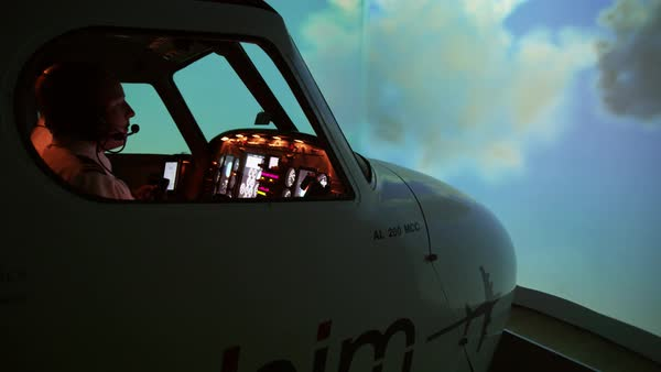 Tracking shot of pilots and instructor in professional flight simulator  during flight, Malaga, Andalusia, Spain stock footage
