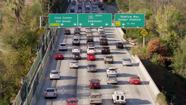 Wide shot of traffic moving on 110 freeway Los Angeles, California, United  States of America stock footage
