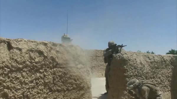 War in Afghanistan - U S  Marines returning heavy small arms fire Kajaki  Afghanistan 2012 stock footage