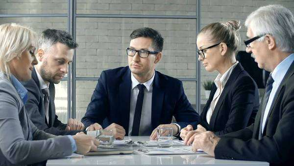 Close up of five business people discussing document details Royalty-free stock video