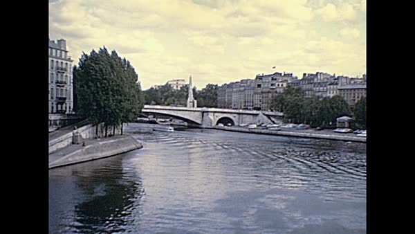 Senna River Of Paris Panorama From Pont Saint Louis Bridge On East Side Of Notre Dame De Paris Gothic Church Historic Restored Footage On 1976 In