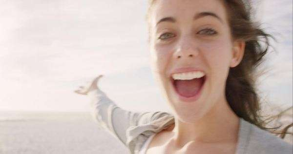 Beautiful woman taking selfie using phone on beach at sunset smiling and spinning enjoying nature and lifestyle on vacation Royalty-free stock video
