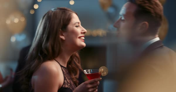 Sexy young couple meet flirting at glamorous party drinking champagne cocktail in love having fun together feeling attraction Royalty-free stock video