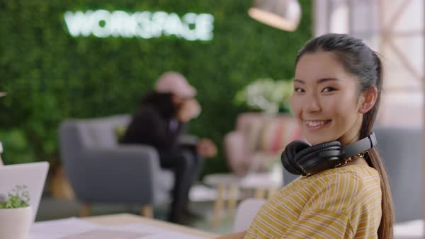 Portrait beautiful young asian woman student smiling happy entrepreneur  enjoying successful career listening to music wearing headphones in trendy