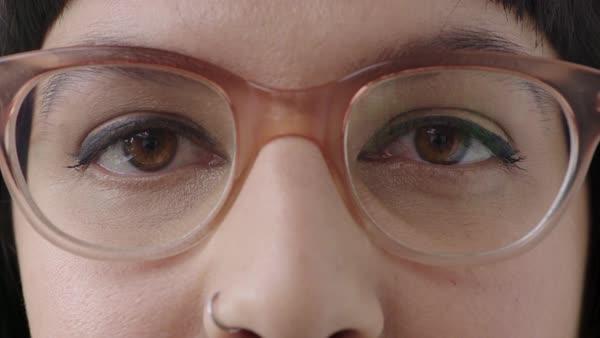 Close Up Young Woman Brown Eyes Looking At Camera Wearing Stylish