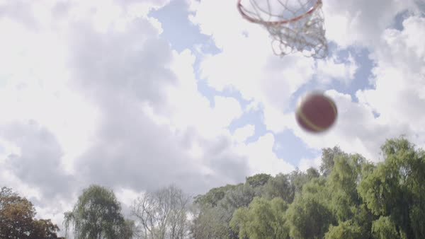 Male basketball player making jump shots as his friend passes him the ball Royalty-free stock video