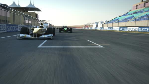 Formula One racecars crossing finishing line - rear cam POV stock footage