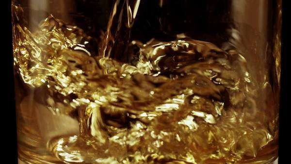 Whiskey poured into glass in slow motion Royalty-free stock video