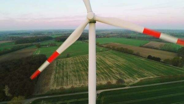 Close-up aerial shot of wind turbine creating sustainable energy Royalty-free stock video