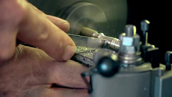 Craftsman polishing and carving piece of metal Royalty-free stock video