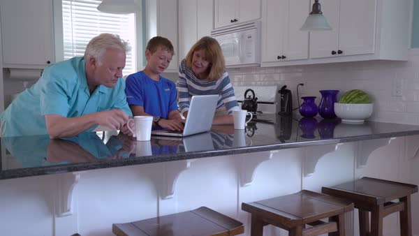 Grandson showing grandparents how to use computer Royalty-free stock video