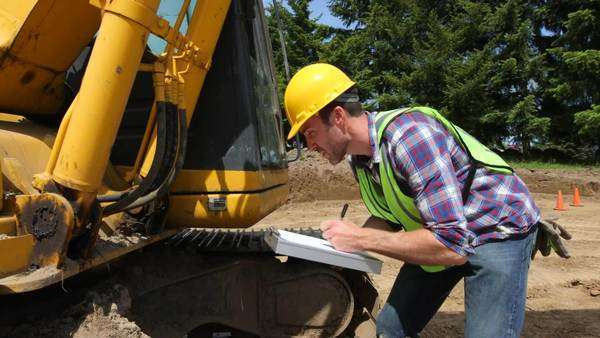 Worker inspecting excavation equipment Royalty-free stock video