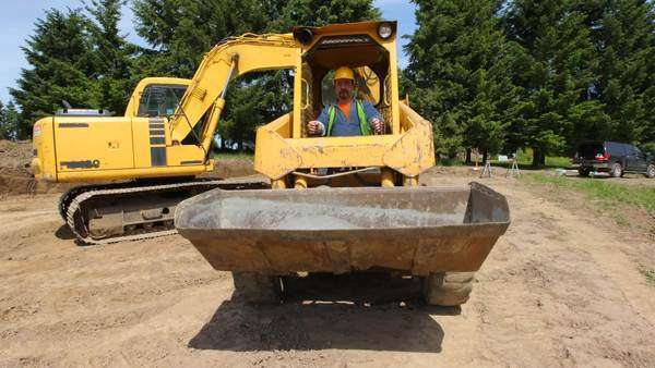 Construction worker driving excavation equipment Royalty-free stock video