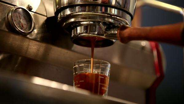 Espresso shot pours from a machine Royalty-free stock video
