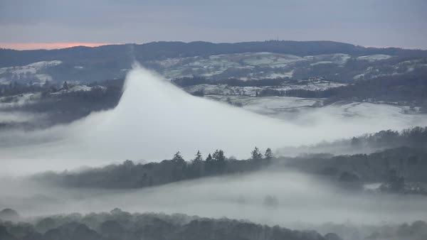 Mountain of mist in a valley. The mist formed beneath a temperature inversion Rights-managed stock video