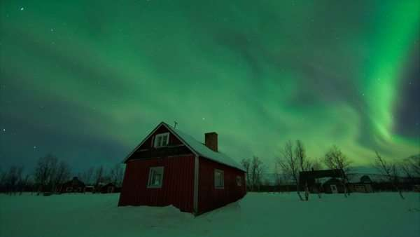 Timelapse footage of the aurora borealis, or northern lights, above a traditional Sami village near Kiruna in Lapland, northern Sweden. Rights-managed stock video