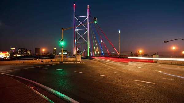 Timelapse of peak traffic time at dusk going to night at the Nelson Mandela Bridge in the city centre of Johannesburg, South Africa Royalty-free stock video