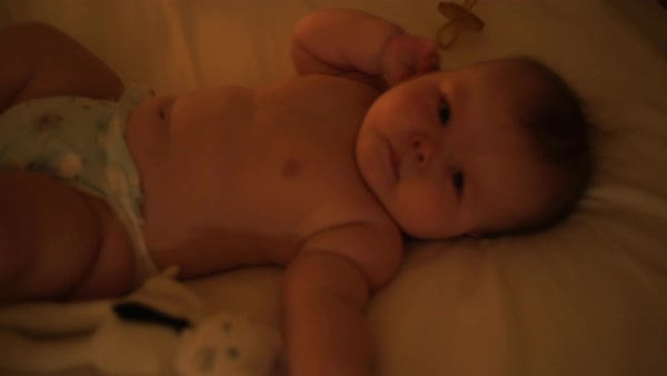Hand-held shot of a baby lying on a bed Royalty-free stock video