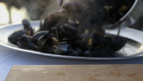 Close-up shot of a person serving mussels on a plate Royalty-free stock video