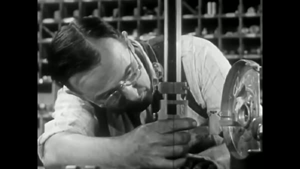 The machinist occupations of tool maker and die maker are described in  1942  stock footage