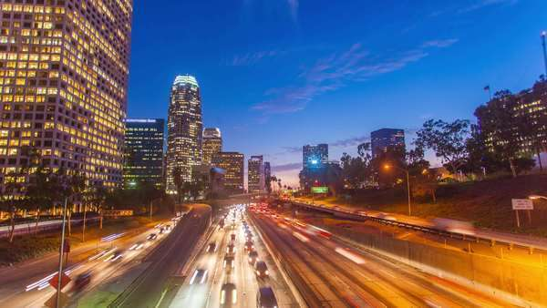 Hyperlapse video view on sunset over buildings and busy freeway traffic, Los Angeles. Transition from day to night Royalty-free stock video
