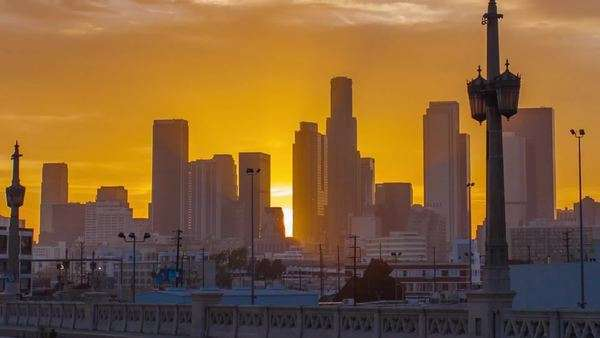 DOWNTOWN, LOS ANGELES, CALIFORNIA, USA - 05 OCTOBER 2014, Red sunset over big city. Timelapse in motion (hyperlapse). Transition from day to night. Spectacular cloudy sky. Close up view on skyscrapers Royalty-free stock video
