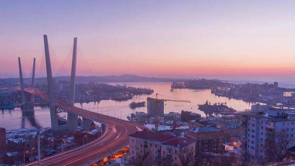VLADIVOSTOK, RUSSIA - 25 JANUARY 2013, timelapse on Golden Horn(Zolotoy Rog) Bridge. Idustrial city nad seaport. Transition from day to night. Royalty-free stock video