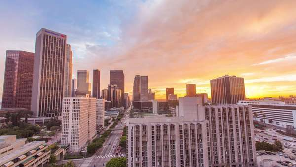 DOWNTOWN, LOS ANGELES, CALIFORNIA, USA - 30 OCTOBER 2014, Timelapse on business buildings and city traffic at spectacular sunset. View from the rooftop of skyscraper.Dramatic cloudscape Royalty-free stock video