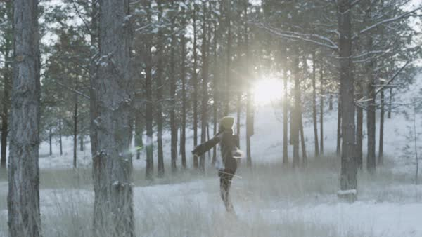 Steadicam shot of a woman spinning in a winter forest Royalty-free stock video