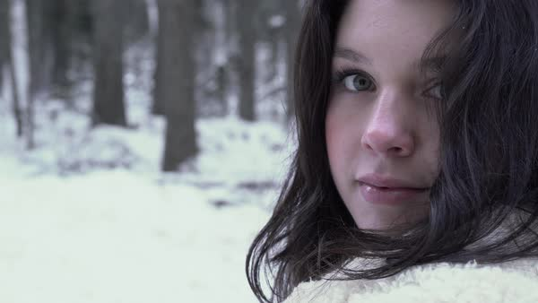 Push-out shot of a young woman standing in a winter forest Royalty-free stock video