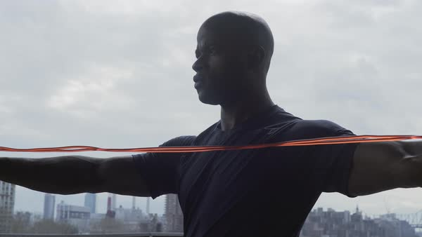 Medium shot of a man exercising with a jump rope Royalty-free stock video