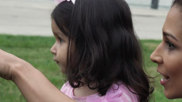 Slow motion shot of a young mother pointing out something to her daughter Royalty-free stock video