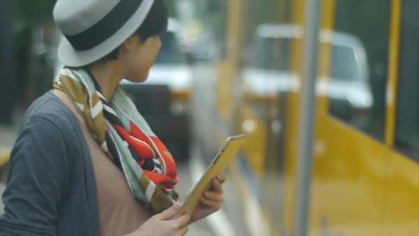 Young Asian Woman With A Digital Tablet Waiting For & Then Getting On A Train Royalty-free stock video