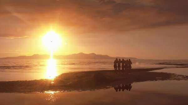 Group Of Five Girls Walking In From A Sandbar At Sunset Royalty-free stock video