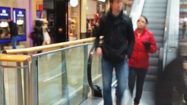 Timelapse sequence showing interior of busy shopping mall with customers getting on and off escalators. Royalty-free stock video