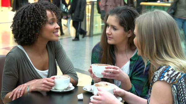 Group Of Young Women Sitting At Caf 233 In Shopping Mall
