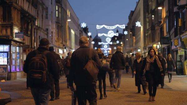 Shoppers walking along busy street in the centre of Oxford beneath Christmas decorations.Shot on Canon 5D MkII at a frame rate of 25fps Royalty-free stock video