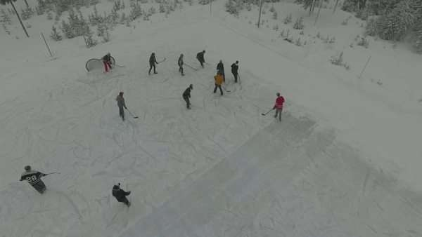 Aerial shot of people playing hockey on a frozen pond Royalty-free stock video