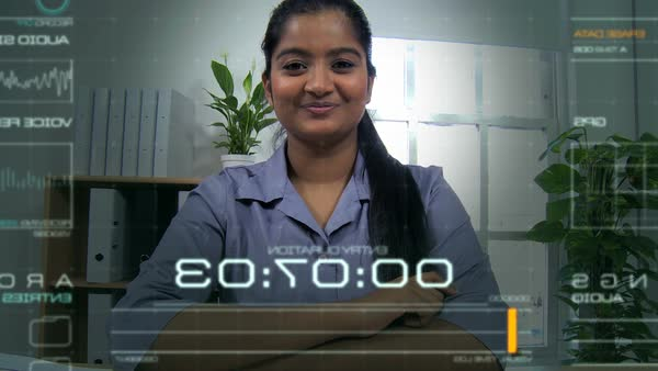 Portrait of attractive Indian female using online video business call  streaming motion graphics virtual reality technology in the office stock  footage