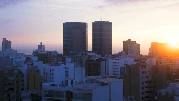 Day to night timelapse illuminated High rise cityscape view of Lima Capital City South America on