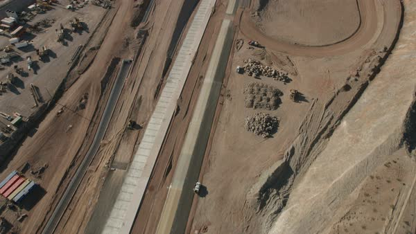Aerial view of new Highway under construction Mojave desert a remote  Extreme Terrain Wilderness area Las Vegas Nevada Southwest USA stock footage