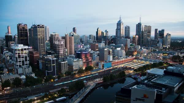 Melbourne Australia - June 2018: Time lapse of dawn to day passenger train  movement Flinders Street Station Melbourne city skyline Victoria Australia