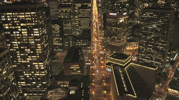 San Francisco - January 2014: Aerial overhead rooftop view night city traffic illuminated city streets skyscrapers San Francisco California USA Royalty-free stock video