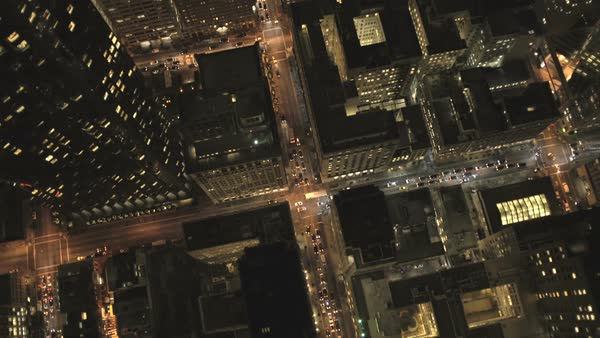 Aerial overhead rooftop view at night city road traffic illuminated by city streets skyscrapers San Francisco California USA Royalty-free stock video