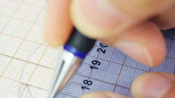 person measuring accurate on the graph paper using ruler and pencil close up stock video footage dissolve