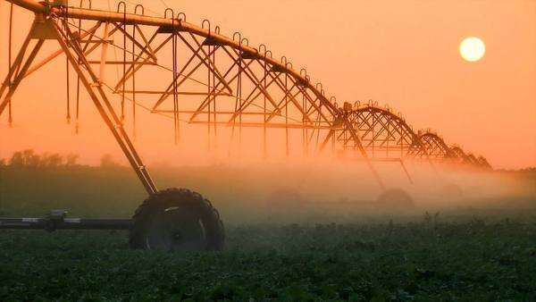 Industrial irrigator spraying water on a field of crops, Nebraska Royalty-free stock video